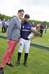 PAUL JAMES Global Brand Leader for St. Regis Hotels & Resorts presents the trophy to Facundo Pieres at the St.Regis International Polo Cup between England and South America held at Cowdray Park, West Sussex on 18th May 2013.  South America won by 11 goals to 9 goals.