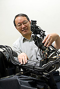 Professor Masatoshi Ishikawa poses with one of his robotic hands developed at Ishikawa-Oku lab at the University of Tokyo, Tokyo, Japan. Photographer: Robert Gilhooly