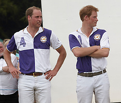 (L-R) Picture shows: Prince WIlliam and Prince Harry at the presentations after playing polo at Cirencester Park. Prince William and Prince Harry.<br /> Jerudong Trophy polo match at Cirencester Park, between Cirencester Purple and Cirencester Black, <br /> Gloucester, United Kingdom, Sunday July 14, 2013.<br /> Photo by: i-Images