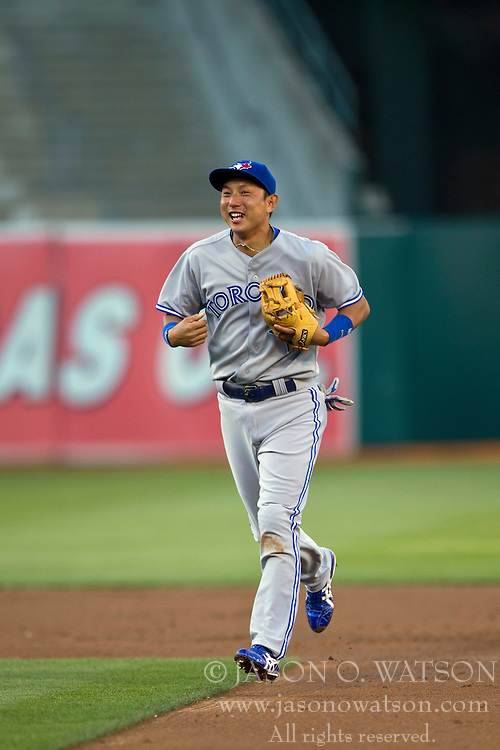 OAKLAND, CA - JULY 05:  Munenori Kawasaki #66 of the Toronto Blue Jays returns to the dugout after the first inning against the Oakland Athletics at O.co Coliseum on July 5, 2014 in Oakland, California. The Oakland Athletics defeated the Toronto Blue Jays 5-1.  (Photo by Jason O. Watson/Getty Images) *** Local Caption *** Munenori Kawasaki