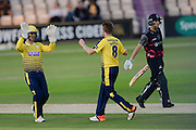 Liam Dawson and Lewis McManus of Hampshire celebrate the wicket of Ryan Davies during the NatWest T20 Blast South Group match between Hampshire County Cricket Club and Somerset County Cricket Club at the Ageas Bowl, Southampton, United Kingdom on 29 July 2016. Photo by David Vokes.