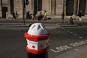 City of London bollard and street sweeper contractor pauses during shift outside the Bank of England.