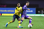 Oxford United midfielder Tarique Fosu-Henry  (11) battles for possession  with Shrewsbury Town defender Donald Love (17) during the EFL Sky Bet League 1 match between Oxford United and Shrewsbury Town at the Kassam Stadium, Oxford, England on 7 December 2019.