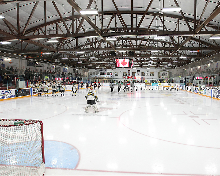 TRENTON, ON  - MAY 5,  2017: Canadian Junior Hockey League, Central Canadian Jr. &quot;A&quot; Championship. The Dudley Hewitt Cup. Game 7 between Georgetown Raiders and the Powassan Voodoos. Players during the National Anthem.<br /> (Photo by Tim Bates / OJHL Images)