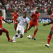 USA forward Juan Agudelo (9) dribbles the ball past Panama midfielder Gabriel Gómez (6) and Panama defender Luis Henríquez (17) during a CONCACAF Gold Cup soccer match between the United States and Panama on Saturday, June 11, 2011, at Raymond James Stadium in Tampa, Fla. (AP Photo/Alex Menendez)