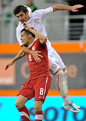 (L) Pawel Brozek of Poland & Ucha Lobzhanidze of Georgia fight for the ball during friendly soccer match between Poland and Georgia in Lubin, Poland...Poland, Lubin , August 10, 2011..( Photo by © MEDIASPORT )..PICTURE ALSO AVAIBLE IN RAW OR TIFF FORMAT ON SPECIAL REQUEST.