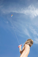 Boy (7-9) flying kite low angle view