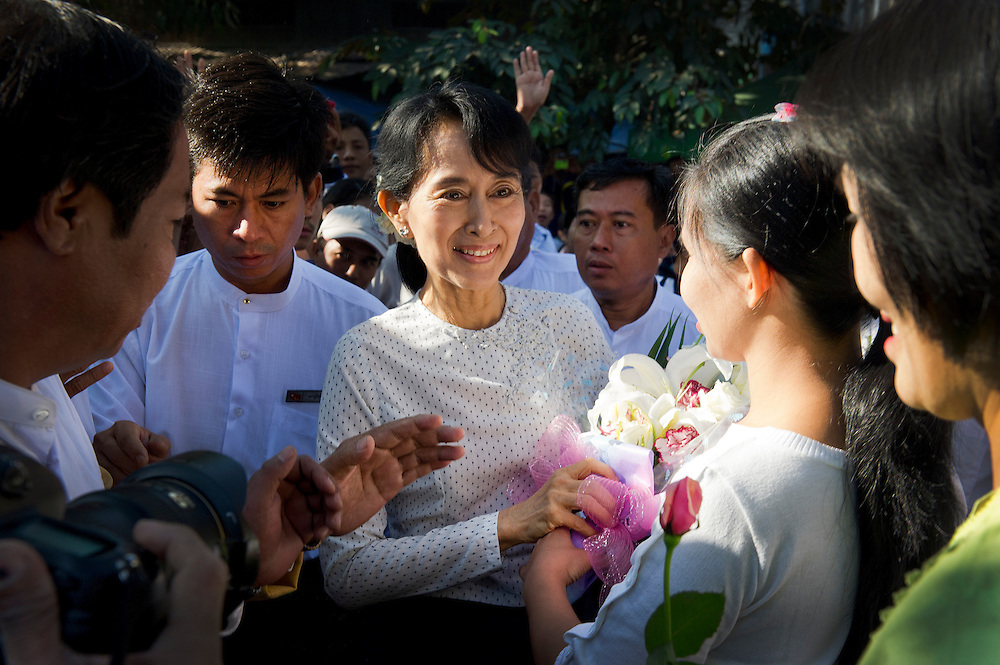 The National League of Democracy (NLD) head, Pro-democracy leader Aung San Suu Kyi is mobbed by supporters as she visits the home of the family of Ute Ma We, a man who died in prison some twenty years ago..