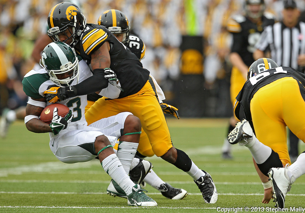 October 6 2013: Michigan State Spartans returner Macgarrett Kings Jr. (3) is hit by Iowa Hawkeyes linebacker Christian Kirksey (20) during the first quarter of the NCAA football game between the Michigan State Spartans and the Iowa Hawkeyes at Kinnick Stadium in Iowa City, Iowa on October 6, 2013.