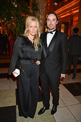 DAVINIA TAYLOR and MATTHEW LEYDEN at the inaugural dinner for The Queen Elizabeth Scholarship Trust hosted by Viscount Linley at the V&A museum, London on 25th February 2016.