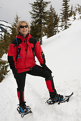 North America, United States, Washington, Crystal Mountain, woman on snowshoes, MR