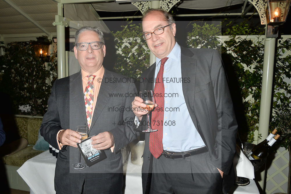 Left to right, DOMINIC LAWSON and NIGEL NEWTON (CEO, Bloomsbury Publishing) at a party to celebrate the publication of Right or Wrong: The Memoirs of Lord Bell held at Mark's Club, Charles Street, London on 16th October 2014.