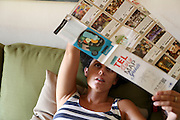 Young woman studies a map of Tel Aviv, Israel Model release available