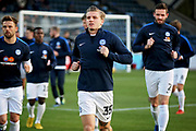 Peterborough United forward Jason Cummings (35) leads the Posh team in the warm up before the EFL Sky Bet League 1 match between Wycombe Wanderers and Peterborough United at Adams Park, High Wycombe, England on 3 November 2018.
