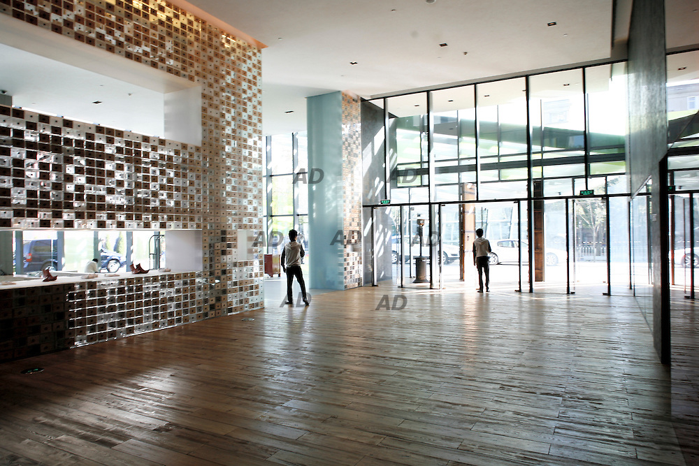 The first boutique hotel by Swire Hotels, the property, opened its doors in time to welcome swarms of Olympic revelers and the first shoppers at the Village at Sanlitun, the neighboring open-plan leisure, shopping and cultural community. Swire Properties acquired the site for The Village at Sanlitun, a shopping and entertainment destination, with plans for a boutique hotel within it. In Chinese culture, the phrase ?opposite house? refers to the guesthouse which is customarily located on the other side of a traditional courtyard home. The hotel group chose award-winning Kengo Kuma and Associates to bring the vision to life with the exterior and interior design.