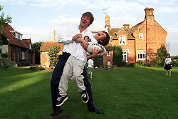 Max Dolbey was picked to star in the lead of American TV/film version of David Copperfield. Max Dolbey 10 .(trousers), photographed here with his Dad, Alex, at their home in Suffolk, May 16, 2000. Photo by Andrew Parsons / i-images..