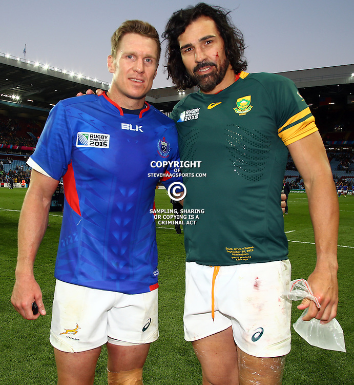 BIRMINGHAM, ENGLAND - SEPTEMBER 26: Jean de Villiers (captain) with Victor Matfield of South Africa during the Rugby World Cup 2015 Pool B match between South Africa and Samoa at Villa Park on September 26, 2015 in Birmingham, England. (Photo by Steve Haag/Gallo Images)