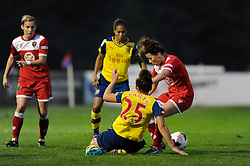 Bristol Academy's Angharad James battles for the ball with Arsenal Ladies' Jade Bailey - Photo mandatory by-line: Dougie Allward/JMP - Mobile: 07966 386802 - 20/09/2014 - SPORT - FOOTBALL - Bristol - SGS Wise Campus - BAWFC v Arsenal Ladies - FA Womens Super League