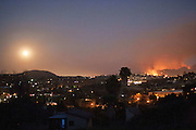 San Marcos, California, U.S. - <br /> <br /> California Wildfires 2014 - Cocos Fire<br /> <br /> Fires burn on the hillside seen from the city of Vista, California as the full moon rises on May 14th, 2014. The Cocos Fire, fronerly known as the Washingtonia Fire has already burned more than 450 acres  in the Village Drive, Twin Oaks Road area of the North San Diego County city of San Marcos.<br /> ©Exclusivepix