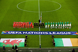 CARDIFF, WALES - Thursday, September 6, 2018: Wales and Republic of Ireland players stand for the national anthem with mascots before the UEFA Nations League Group Stage League B Group 4 match between Wales and Republic of Ireland at the Cardiff City Stadium. Gareth Bale, Aaron Ramsey, Tom Lawrence, Ben Davies, David Brooks, Connor Roberts, Ethan Ampadu, Joe Allen, Chris Mepham, goalkeeper Wayne Hennessey and captain Ashley Williams. (Pic by Laura Malkin/Propaganda)