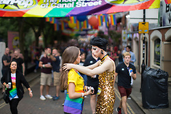 © Licensed to London News Pictures . 25/08/2017. Manchester , UK. People at the opening night of Manchester Pride's Big Weekend in the Gay Village . The annual festival , which is the largest of its type in Europe , celebrates LGBT life . Photo credit: Joel Goodman/LNP