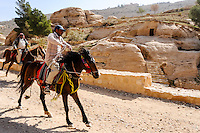 Petra is Jordan's most visited tourist attraction. Horse riders close to the visitor centre.