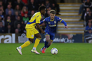 Jake Reeves midfielder for AFC Wimbledon (8) and Tarique Fosu-Henry striker Accrington Stanley (30) during  the Sky Bet League 2 Play-Off first leg match between AFC Wimbledon and Accrington Stanley at the Cherry Red Records Stadium, Kingston, England on 14 May 2016. Photo by Stuart Butcher.