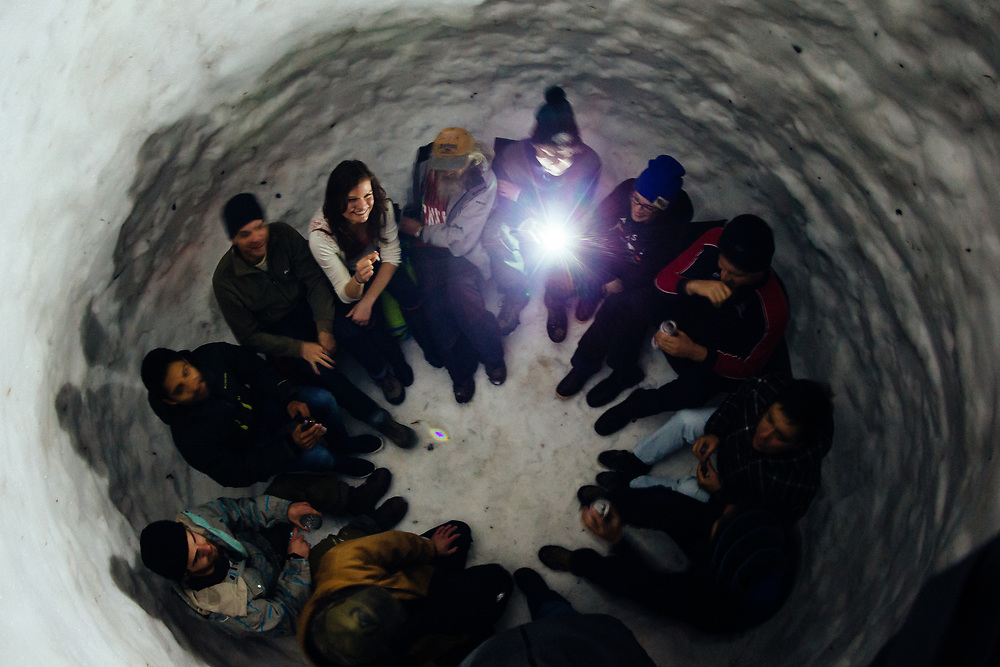 A group of spectators and Hostel X team members hand out in the igloo during team practice.