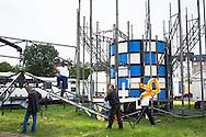 DEU, Germany, Duesseldorf, fun fair at the banks of the river Rhine in the town district Oberkassel, dismounting of the ride Rotor [the Rotor is a large rotating drum where the visitors are standing with their backs to the wall. When the rotation of the drum is fast enough the floor drives down. By the centrifugal force the visitor cleaves at the wall, the centrifugal force defeats the gravitation force].<br /> <br /> DEU, Deutschland, Duesseldorf, Kirmes auf den Rheinwiesen im Stadtteil Oberkassel, Abbau des Fahrgeschaefts Rotor der Schaustellerfamilie Pluschies [der Rotor ist eine grosse sich drehende Trommel, bei der der Besucher sich mit dem Ruecken zur Wand stellt. Dreht sich die Trommel schnell genug, wird der Boden nach unten gefahren. Der Besucher klebt durch die Fliehkraft an der Wand, die Fliehkraft siegt ueber die Schwerkraft].