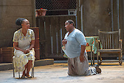 10/07/2012. Cape Town Opera return to the London Coliseum this July with their acclaimed production of Porgy and Bess.Picture shows: Miranda Tina (Maria) and Victor Ryan Robertson (Sporting Life).