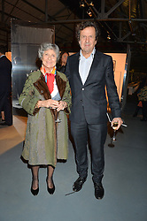 JOAN BURSTEIN and her son SIMON BURSTEIN at the Women for Women International Catwalk Show & Auction in partnership with Brown's and sponsored by Swarovski held at The Vinyl Factory, Brewer Street Space, Brewer Street, London on 20th November 2014.