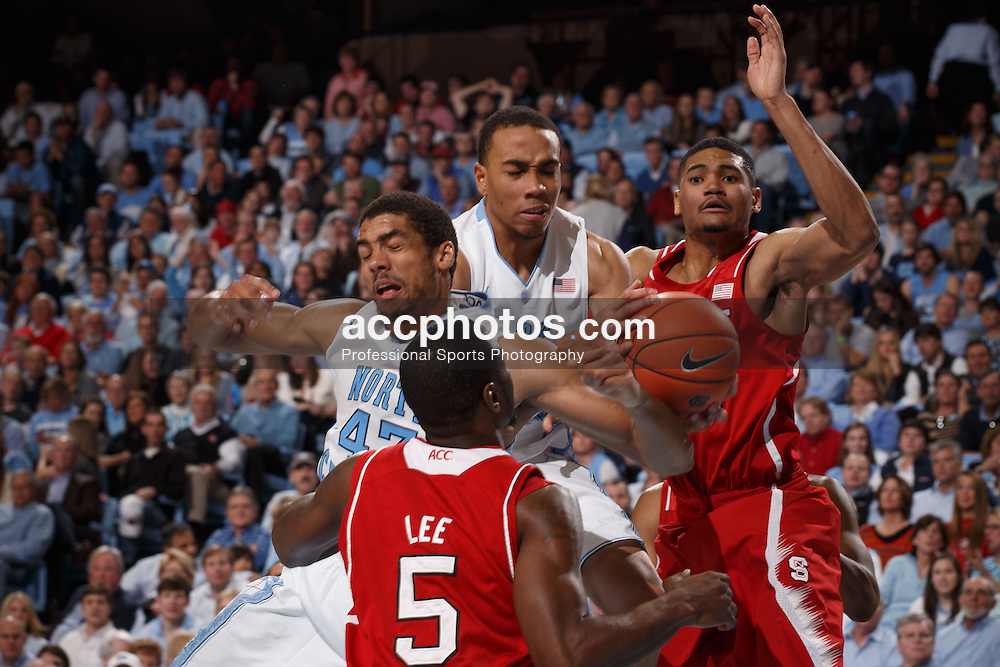 CHAPEL HILL, NC - FEBRUARY 01: James Michael McAdoo #43, Brice Johnson #11 of the North Carolina Tar Heels and Kyle Washington #32 of the North Carolina State Wolfpack battle for possession on February 01, 2014 at the Dean E. Smith Center in Chapel Hill, North Carolina. North Carolina won 70-84. (Photo by Peyton Williams/UNC/Getty Images) *** Local Caption *** James Michael McAdoo;Brice Johnson;Kyle Washington