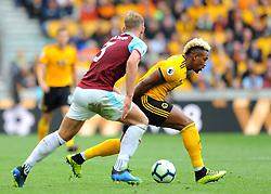 Adama Traore of Wolverhampton Wanderers gets past Charlie Taylor of Burnley- Mandatory by-line: Nizaam Jones/JMP- 16/09/2018 - FOOTBALL - Molineux - Wolverhampton, England - Wolverhampton Wanderers v Burnley - Premier League