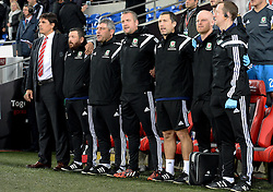 Wales Manger Chris Coleman sings the wales national anthem with his back room staff. - Photo mandatory by-line: Alex James/JMP - Mobile: 07966 386802 - 13/10/2014 - SPORT - Football - Cardiff - Cardiff City Stadium - Wales v Cyprus - EURO 2016 Qualifiers