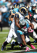 St. Louis Rams defensive end Eugene Sims (97) tackles Carolina Panthers fullback Mike Tolbert (35) in the end zone for a first quarter safety that cuts the Carolina Panthers lead to 7-2 during the NFL week 7 football game against the Carolina Panthers on Sunday, Oct. 20, 2013 in Charlotte, N.C.. The Panthers won the game 30-15. ©Paul Anthony Spinelli