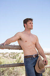 shirtless muscular cowboy on a working ranch