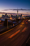 On the Ponsonby off ramp bridge looking over motorway towards Auckland city,  at dawn on Sunday morning. New Zealand