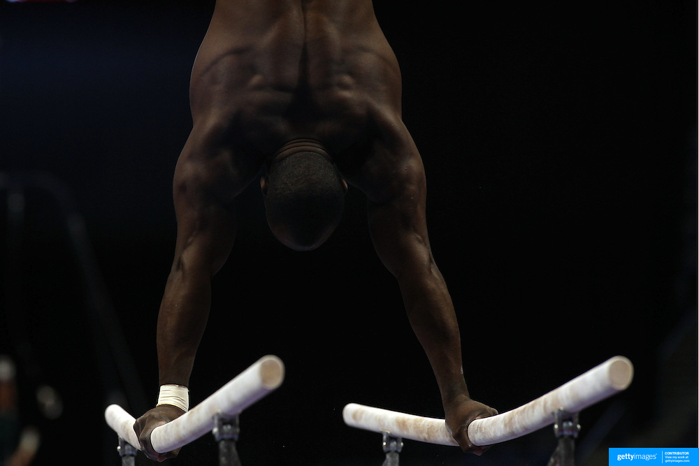 Athletes show their muscles and physique during warm up on the Parallel bars before competiton during the Senior Men Competition at The 2013 P&G Gymnastics Championships, USA Gymnastics' National Championships at the XL, Centre, Hartford, Connecticut, USA. 16th August 2013. Photo Tim Clayton