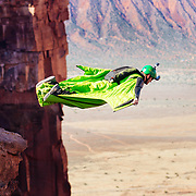 James jumping off Adobe Mesa with his wingsuit in Castleton Valley, UTAH