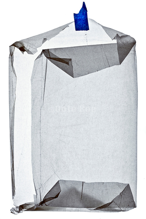 crumpled semi transparent protection paper folded as an envelope