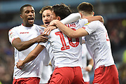 The Nottingham Forest players  celebrate Nottingham Forest forward Joao Carvalho (10) goal 0-2 during the EFL Sky Bet Championship match between Aston Villa and Nottingham Forest at Villa Park, Birmingham, England on 28 November 2018.