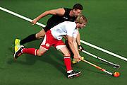 Alex Shaw of New Zealand chases down Ashley Jackson of England. Glasgow 2014 Commonwealth Games. Hockey, Black Sticks Men v England, Glasgow Green Hockey Centre, Glasgow, Scotland. Tuesday 29 July 2014. Photo: Anthony Au-Yeung / photosport.co.nz