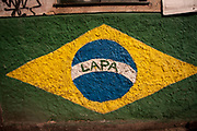 BRIGHTLY PAINTED BRAZILIAN<br />  FLAG ON A WALL RIO