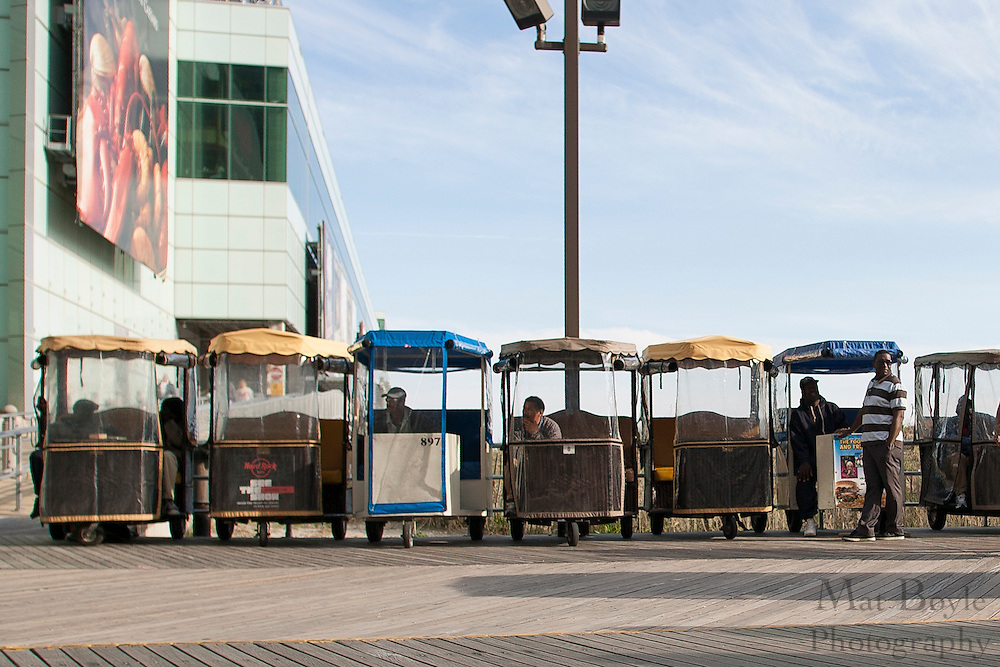 Rolling chairs line across  from Caesars Place casino in Atlantic City, NJ on April 21, 2011.