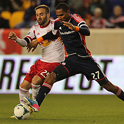 Jerry Bengston, (right), New England Revolution, challenged by Brandon Barklage, New York Red Bulls, during the New York Red Bulls V New England Revolution, Major League Soccer regular season match at Red Bull Arena, Harrison, New Jersey. USA. 20th April 2013. Photo Tim Clayton
