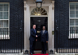 © Licensed to London News Pictures. 04/02/2013. London, UK. The Somali President, Sheikh Shariff Ahmed (R), shakes hands with the British Prime Minister, David Cameron, as he visits number 10 Downing Street for talks today (04/02/13).  Photo credit: Matt Cetti-Roberts/LNP