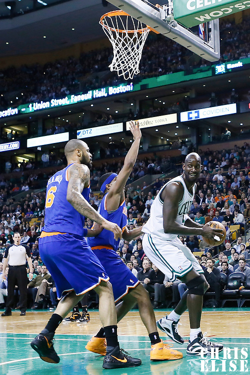 24 January 2013: Boston Celtics power forward Kevin Garnett (5) looks to pass the ball over New York Knicks shooting guard James White (4) and New York Knicks center Tyson Chandler (6) during the New York Knicks 89-86 victory over the  at the TD Garden, Boston, Massachusetts, USA.