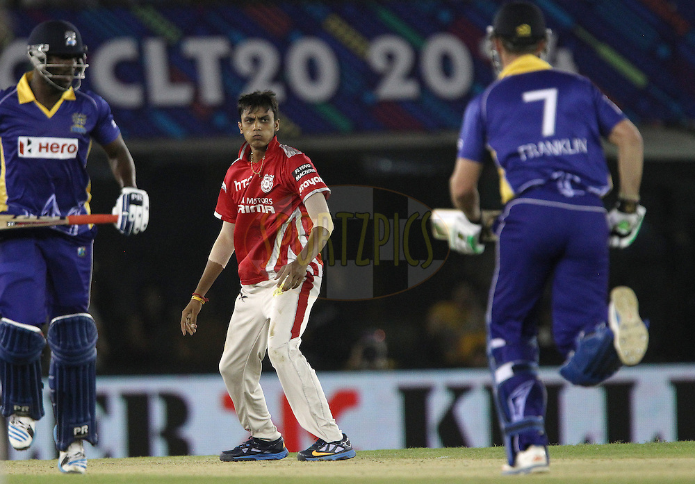 Akshar PATEL of the Kings XI Punjab  during match 5 of the Oppo Champions League Twenty20 between the Kings XI Punjab and the Barbados Tridents held at the Punjab Cricket Association Stadium, Mohali, India on the 20th September 2014<br /> <br /> Photo by:  Ron Gaunt / Sportzpics/ CLT20<br /> <br /> <br /> Image use is subject to the terms and conditions as laid out by the BCCI/ CLT20.  The terms and conditions can be downloaded here:<br /> <br /> http://sportzpics.photoshelter.com/gallery/CLT20-Image-Terms-and-Conditions-2014/G0000IfNJn535VPU/C0000QhhKadWcjYs