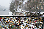 France. Paris. 1st district. the quay du louvre  on the Seine river covered with snow