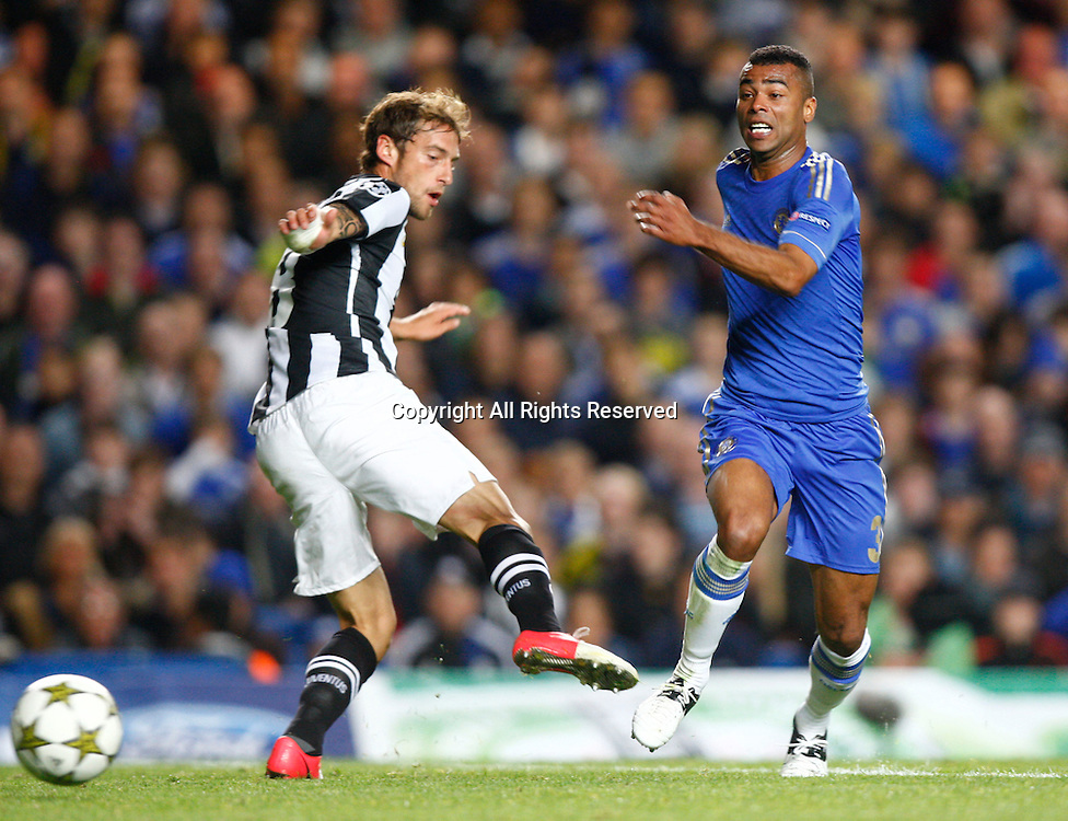 19.09.12 London, ENGLAND: <br /> Ashley Cole of Chelsea and Claudio Marchisio of Juventus F.C.<br /> during the UEFA Champions League Group E match between Chelsea and  Juventus at Stamford Bridge Stadium